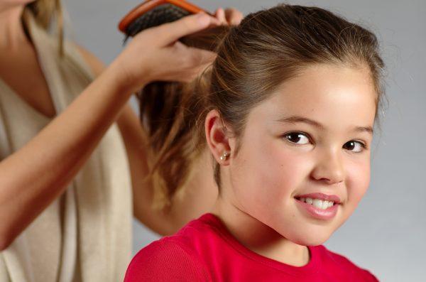 Волосы девочки, собранные в хвост